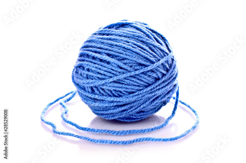 Blue ball of woollen thread isolated on white