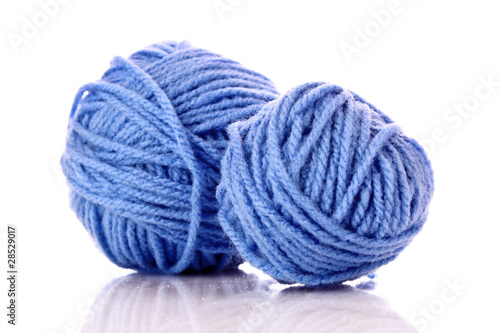 Blue balls of woollen thread isolated on white