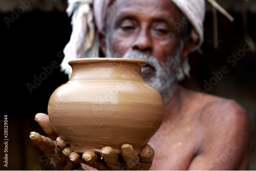 Indian Potter Showing a Pot
