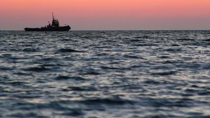 Sea sunset. Tugboat.