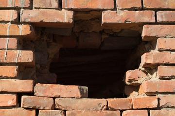 a hole on brick wall