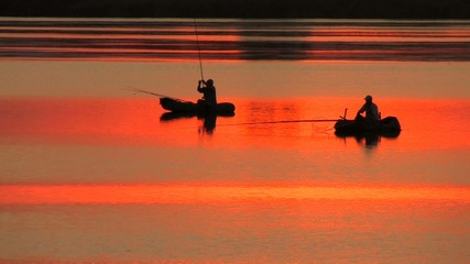 Fishing boats in Orange Water at Sunset