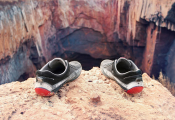 shoes of the suicide on the brink of a precipice