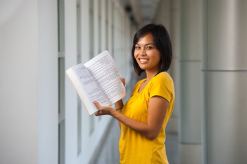 Cute Smiling College Girl Open Textbook