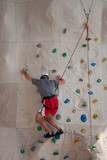 Rock Wall Climber in Red and White Shorts