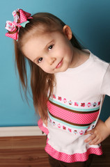 Little girl modeling hair bow and matching shirt