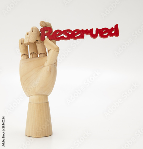 Wooden hand holding Reserved sign