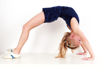 Girl child performing gymnastics