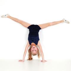 Girl child performing gymnastics