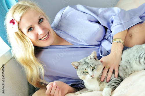happy pregnant woman with cat