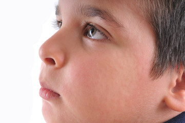 Close up image of a little boy's face suffering urticaria.