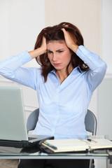 Portrait of worried businesswoman