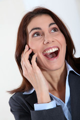 Businesswoman on the phone with surprised look