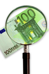magnifying glass with one hundred euro bill