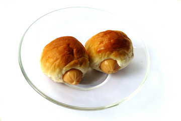 Two sausage sandwich  on glass disk isolated