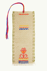 The embroidered bookmark for the book