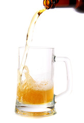 Beer flows from a bottle in a glass,isolated.