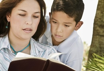 Mother And Son Reading A Bible
