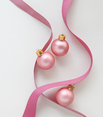 pink Christmas ornaments with grosgrain ribbons