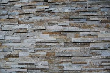 Wall of multicolored stacked stone