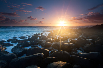 sunrise with interesting full of rocks foreground
