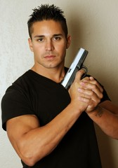 Isolated image of young male with firearm