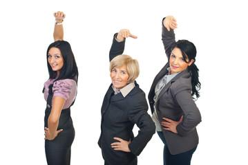 Team of businesswomen stretching hands