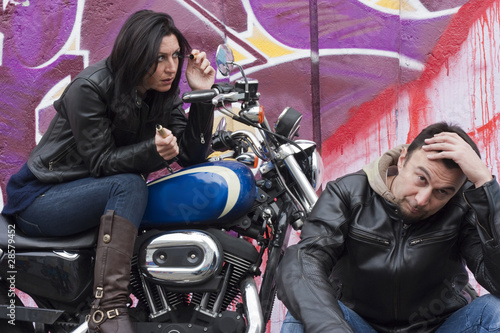Bored Motorcycle Man and Biker Girl Making Up