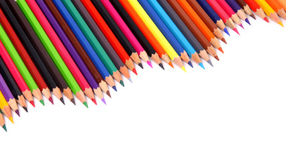 Close up of color pencils with different color over white