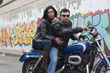 A Couple of Motorcycle Riders with their Custom Bike