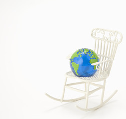 Glass Globe on miniature rocking chair