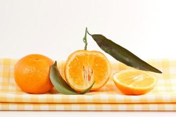 Tangerines on a yellow napkin