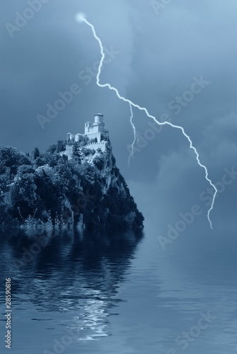 isolated castle on the rocks over the lake