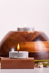 Candle with Flame on Wood Block