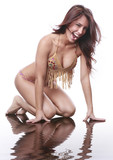 Hot young brunette in fringed bikini isolated poster