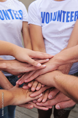 volunteer group hands together