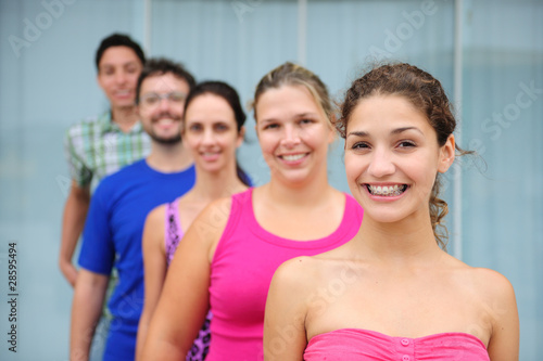 group of casual real people, teenage girl in front