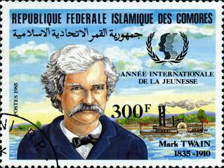 Mark Twain. 1835-1910. Timbre rep Comores.