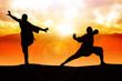 Silhouette illustration of two figures doing martial art stance