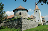 Fortified church with defense wall. Racos, Transylvania, Romania poster