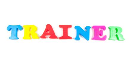trainter written in fridge magnets on white background