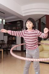 Asian kid hula hooping