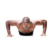 Muscular young man doing push ups exercise