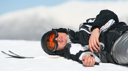 Skier relaxing on the top of the mountain