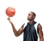 Attractive young man playing with the basketball