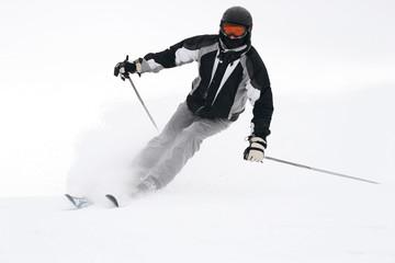 Skier on sliding down a slope