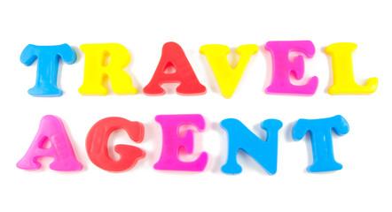 travel agent written in fridge magnets on white background