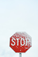 Stop sign with snow