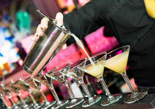 barman's hand with shaker and cocktails