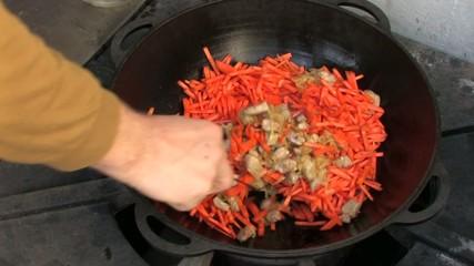Stirring Pilaf ingredients in Wok, Closeup